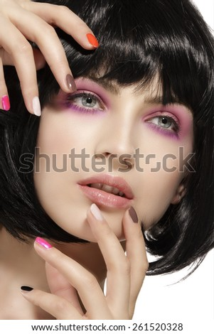 Beauty model hairstyled  and pink eye shadows makeup  closeup on white