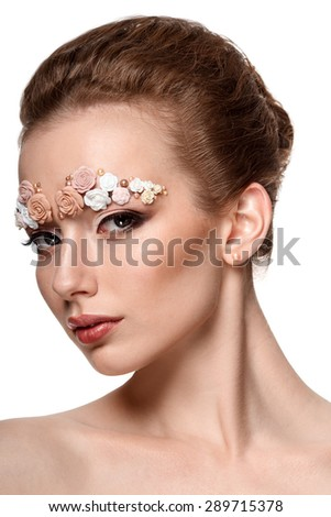 beauty model portrait with creative makeup,  eyebrows from flowers - stock photo