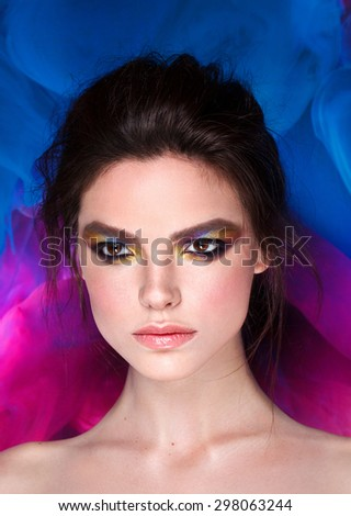 Beauty model with art make up. Strong eyes. Fashion style.  - stock photo