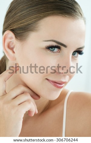 Beauty Model with  Perfect Fresh Skin and Long Eyelashes. Youth and Skin Care Concept. Spa and Wellness. Make up and Hair. Lashes. Close up, selected focus. - stock photo
