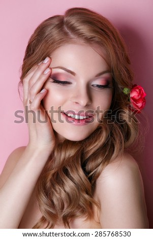 Beauty Model Woman Face. Perfect Skin. Professional Make-up.Makeup. Beautiful young girl with a floral ornament in her hair.Beautiful Woman Touching her Face.  - stock photo