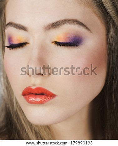 Beauty Model Woman .Healthy Hair and Beautiful Professional Makeup. Red Lips and rainbow Make up. Gorgeous Glamour Lady Portrait. Haircare, Skincare concept