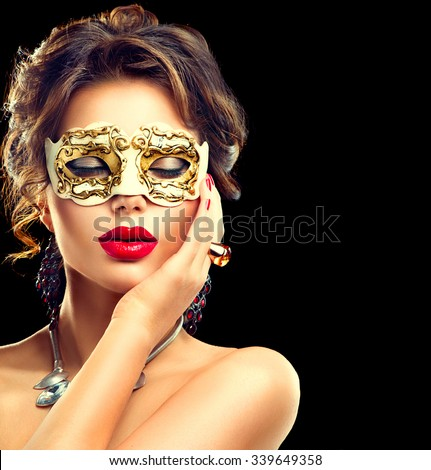 Beauty model woman wearing venetian masquerade carnival mask at party isolated on black background. Christmas and New Year celebration. Glamour lady with perfect make up and hairstyle - stock photo