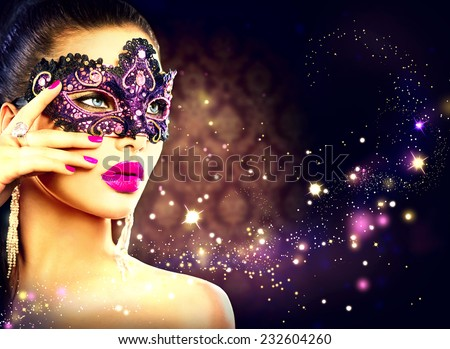 Beauty model woman wearing venetian masquerade carnival mask at party over holiday dark background with magic stars. Christmas and New Year celebration. Glamour lady - stock photo