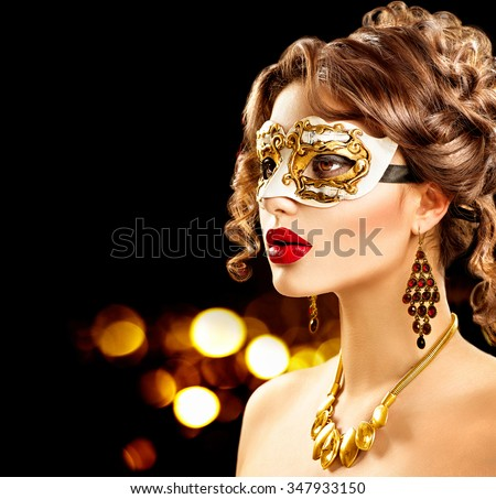 Beauty Model Woman Wearing Venetian Masquerade Carnival Mask At Party Over Holiday Dark Background With Magic