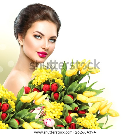 Beauty model Woman with Spring Flower bouquet. Beautiful girl with a Bunch of colorful Tulip flowers. Happy surprised model woman smelling flowers. Mother's Day. Springtime - stock photo