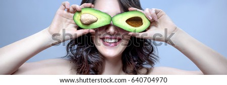 Beauty Model Woman  Young Caucasian Brunette with Avocado. Happy Toothy Smile. Healthy Eating concept. studio shot