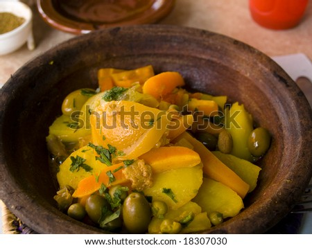 Beauty Moroccoan dish. Tagine, an oriental cooking. - stock photo