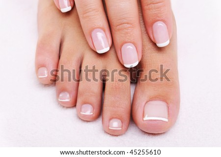 Beauty Nails Concept Of A Female Hand And Feet With Beautiful French Manicure Pedicure