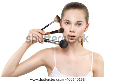 Beauty Nude portrait of a girl with brushes in hand isolated on white background