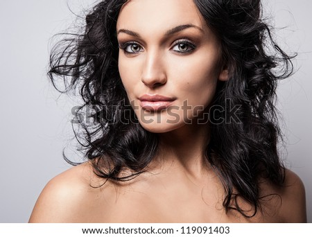 Beauty of a young woman face. Close-up studio portrait.