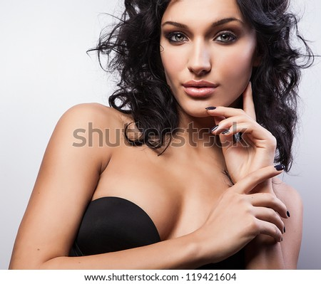 Beauty of a young woman face. Close-up studio portrait. - stock photo