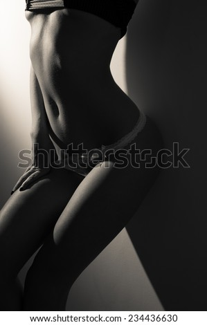 beauty of nudity light and shadow image - stock photo