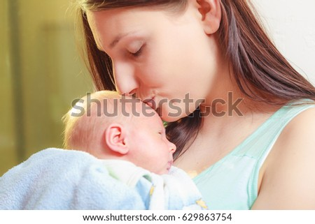 Beauty of parenting, motherhood love concept. Mother holding her little newborn baby
