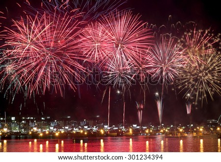beauty of the fireworks reflect on sea water - stock photo
