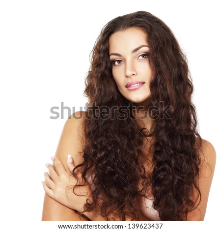 Beauty of young fresh woman with long brown healthy curly hair. Isolated on white background