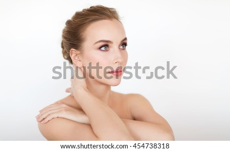 beauty, people and bodycare concept -beautiful young woman face and hands over white background - stock photo
