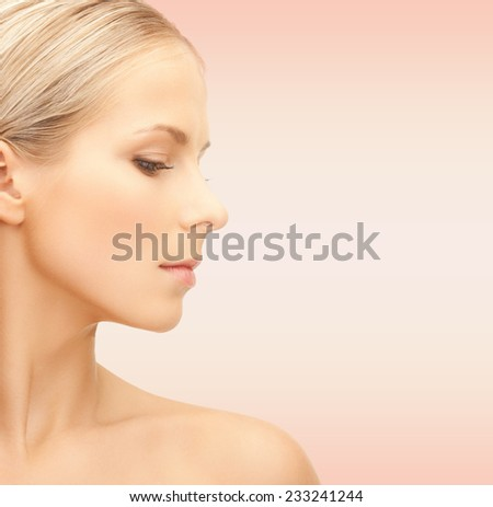 beauty, people and health concept - beautiful young woman face over pink background - stock photo