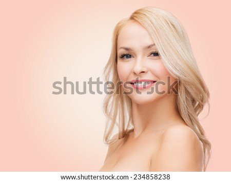 beauty, people and health concept - beautiful young woman with bare shoulders over pink background - stock photo