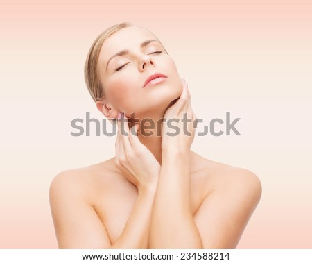 beauty, people and health concept - beautiful young woman with closed eyes touching her neck over pink background - stock photo