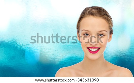 beauty, people and health concept - smiling young woman face with pink lipstick on lips and shoulders - stock photo