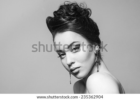 Beauty photo beautiful fashion girl with curious hair.  Black and white photos