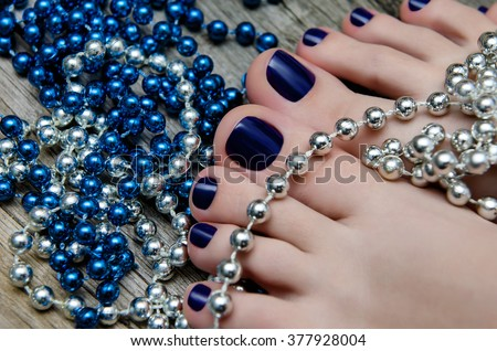 Beauty photo of nice blue pedicured feet - stock photo