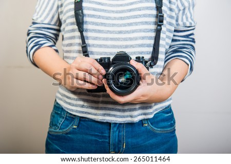Beauty photographer took retro film camera - stock photo