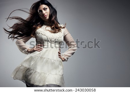 beauty plus size woman with a blowing hair - stock photo