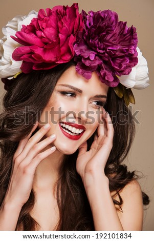 beauty portrair of woman with bright flowers on her head