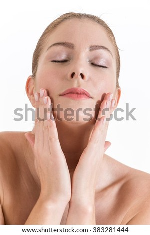 Beauty portrait. Beautiful spa woman touching her face closed eyes