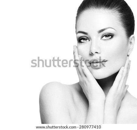 Beauty Portrait. Beautiful Spa Woman Touching her Face. Perfect Fresh Skin. Beauty brunette Model. Youth and Skin Care Concept. Black and white Studio shot - stock photo