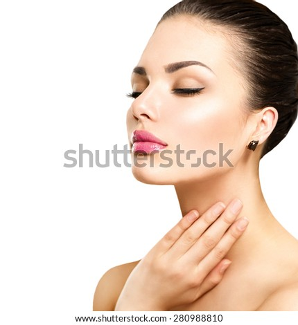 Beauty Portrait. Beautiful Spa Woman Touching her Face. Perfect Fresh Skin. Beauty brunette Model. Youth and Skin Care Concept. Studio shot - stock photo