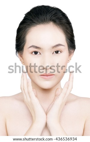 Beauty Portrait. Beautiful Spa Woman Touching her Face. Perfect Fresh Skin. Beauty brunette Model. Youth and Skin Care Concept. Studio shot. Isolated on white background - stock photo