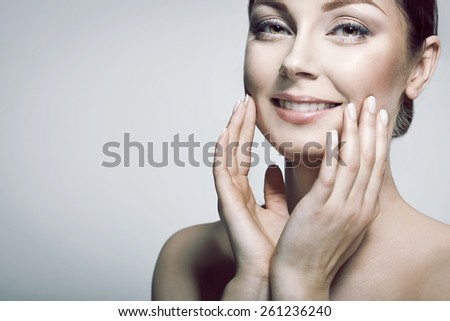 Beauty Portrait. Beautiful Spa Woman Touching her Face. Perfect Fresh Skin. Pure Beautiful Model Girl. Wellbeing and Skin Care Concept . - stock photo