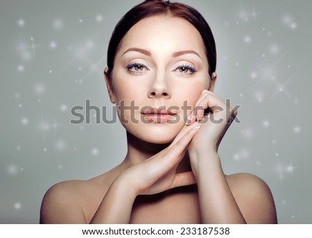 Beauty Portrait. Beautiful Spa Woman Touching her Face. Perfect Fresh Skin. Pure Beauty Model Girl. Youth and Skin Care Concept. Wintertime - stock photo