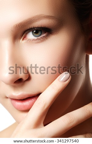 Beauty Portrait. Beautiful spa woman touching her face. Perfect fresh skin. Pure beauty model girl. Youth and skin care concept. Manicure - stock photo