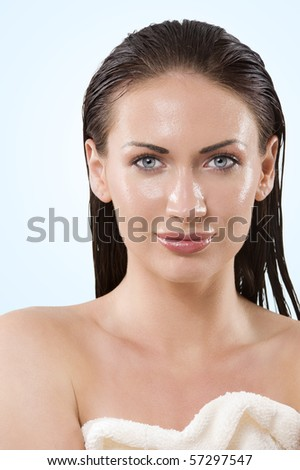 beauty portrait cute model with wet face and hair looking in camera with stunning eyes