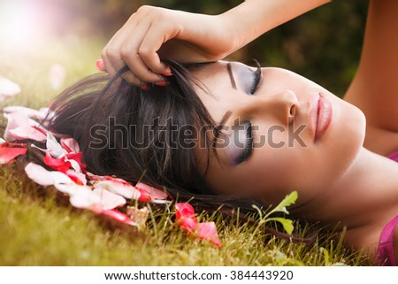 Beauty Portrait. Face of Young Woman and Flower Petals - stock photo