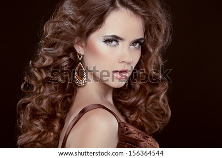 Beauty Portrait. Hairstyle. Brunette woman with Long Healthy Brown Hair isolated over dark background. Elegant lady - stock photo