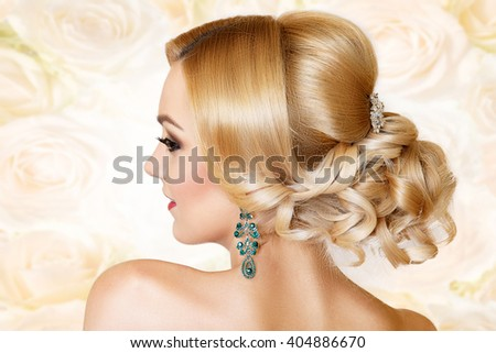 beauty portrait of a beautiful blonde with a festive hair and bright makeup. Girl in jewelry - stock photo