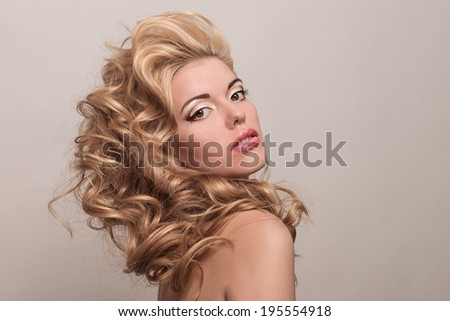 Beauty portrait of a beautiful blonde. Young girl with more voluminous hair. Professional makeup - stock photo