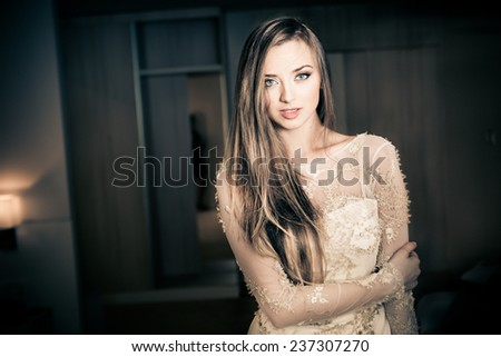 Beauty portrait of a beautiful spa woman in hotel room. Perfect fresh skin. Pure beauty model girl. Youth and skin care concept. Gorgeous bride to be before the wedding - stock photo