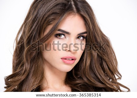 Beauty portrait of a charming woman with long hair looking at camera isolated on a white background - stock photo