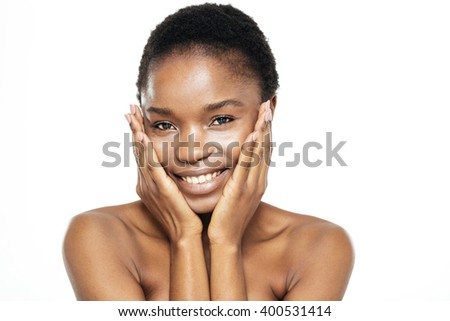 Beauty portrait of a cheerful afro american woman looking at camera isolated on a white background - stock photo