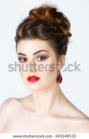 beauty portrait of a girl with clean skin and bright makeup on white background