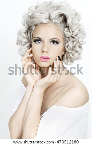 Beauty portrait of a girl with curly silver hair.
