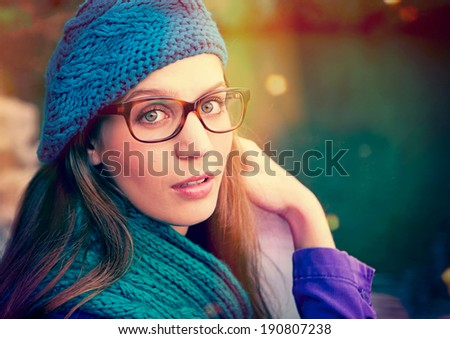 beauty portrait of a girl with glasses - stock photo