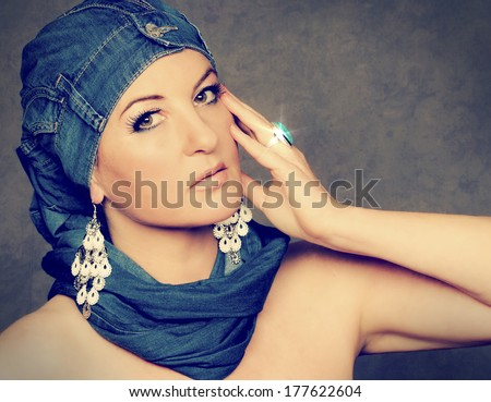 beauty portrait of a girl with jeans on her head - stock photo