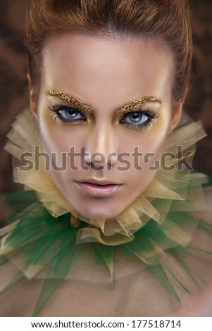 beauty portrait of a golden queen - stock photo